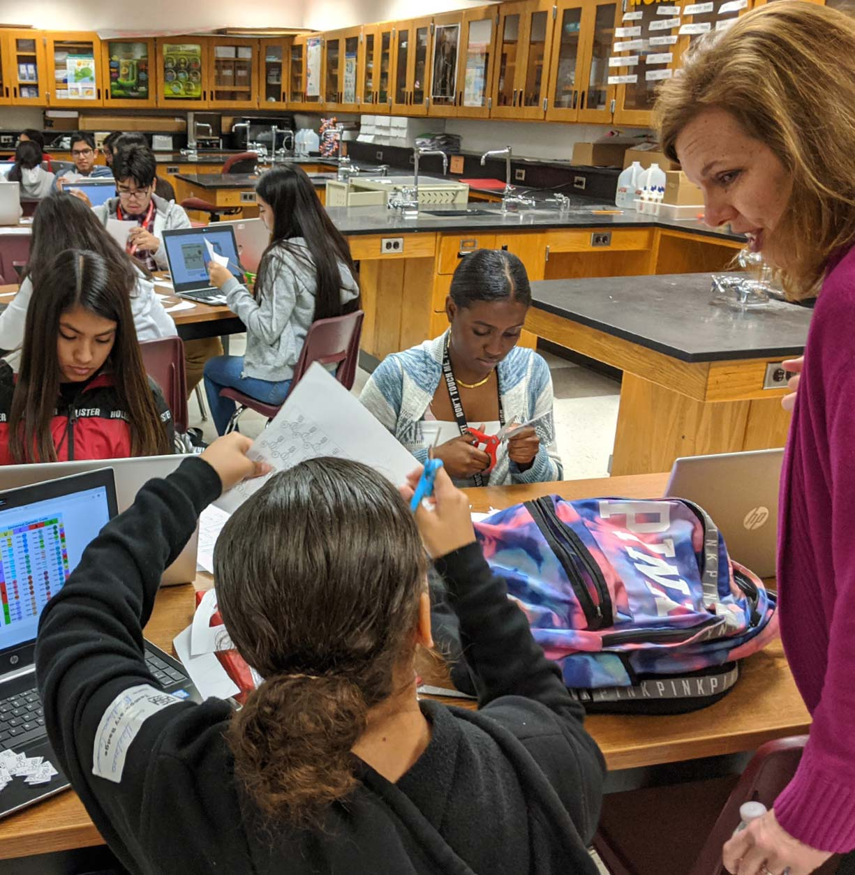 """During the Learning Walk hosted for the """"Districts for Impact"""" Five Conditions Learning Cadre, Assistant Superintendent for Middle Schools Marcy Hetzler-Nettles interacts with students from Immokalee High School."""