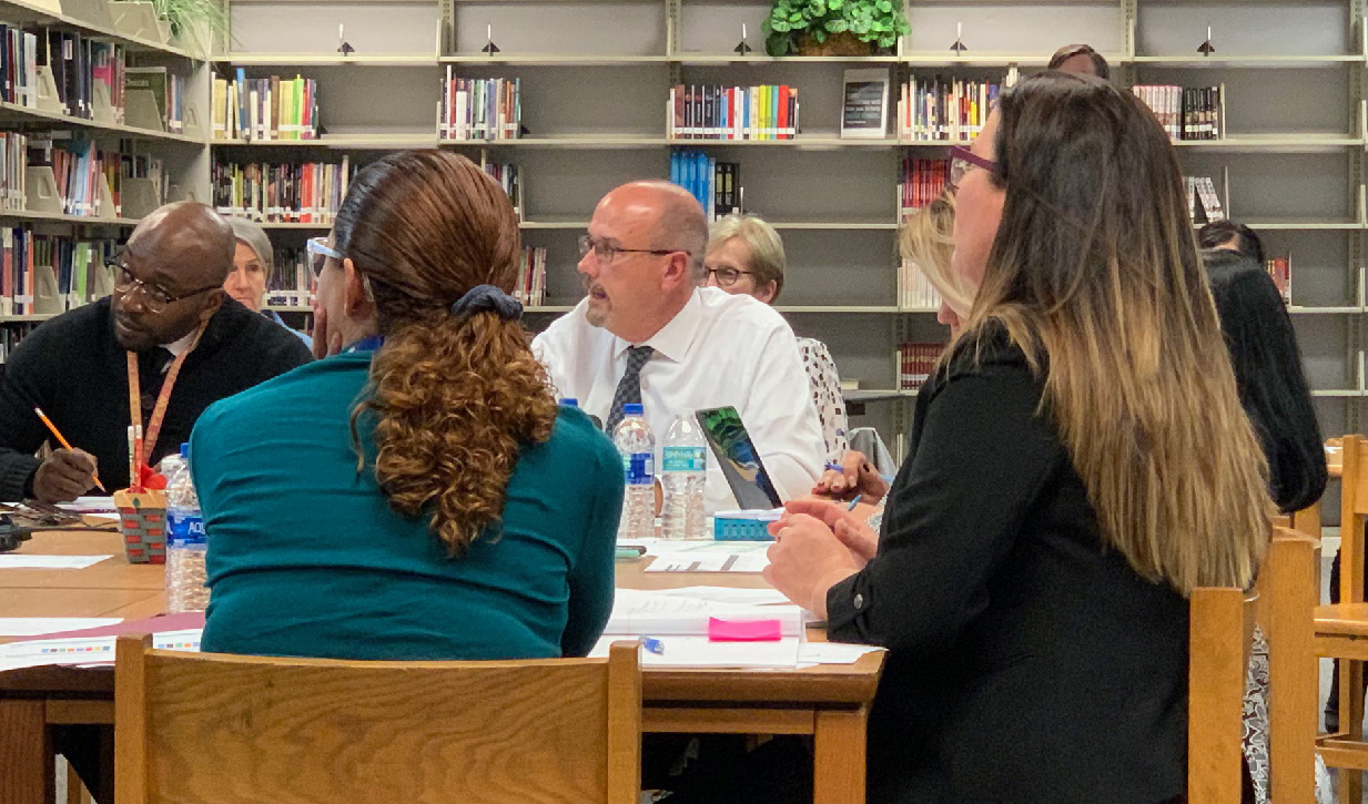 "Gateway High School Principal James Long and team execute a Stocktake while the ""Districts for Impact"" Five Conditions Learning Cadre Observes."